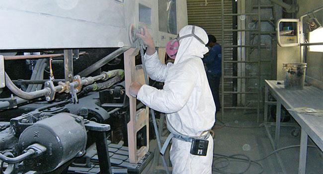 Industrial-Hygiene-worker-sanding-locomotive-larger