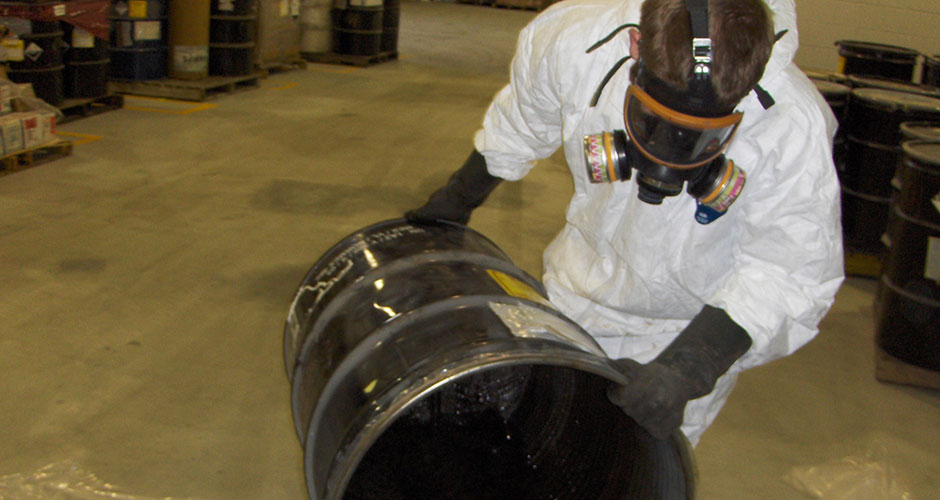 Worker-chemicals-in-barrel-large